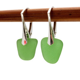A simple elegant pair of genuine sea glass earrings in green.