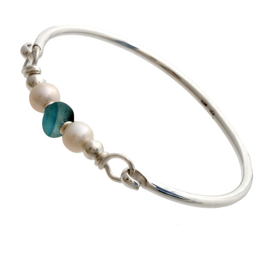 Vivid mixed aqua beach found sea glass combined with real cultured pearls on this solid sterling silver half round sea glass bangle bracelet. Real cultured pearls make the a great choice for a beach wedding or June beach baby!