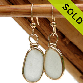 Natural UNALTERED white sea glass earrings set in our Original Wire Bezel© setting in gold.