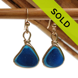 An ultra rare match of mixed English sea glass piece from Seaham England in our Original Gold Wire Bezel© sea glass earring setting. Sorry this Sea Glass Jewelry piece has been SOLD!