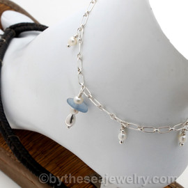 Genuine cornflower blue (periwinkle) sea glass with sterling tear drop bead on a Sterling Silver long and short chain finished with genuine fresh water pearls.