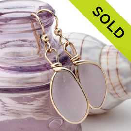 Top quality pale purple or lavender sea glass earrings in our Original Wire Bezel© setting in a rich gold setting.