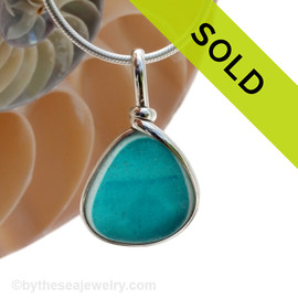 A stunning piece of electric deep aqua English Multi sea glass set for a necklace in our Original Sea Glass Bezel© in solid sterling silver setting. Sorry this piece of sea glass jewelry has been sold!