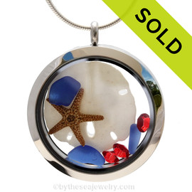 Genuine cobalt blue sea glass pieces combined with a real sandollar, a mini starfish and real beach sand in this JUMBO 35MM stainless steel locket.  Sorry this Sea Glass Jewelry selection has been SOLD!