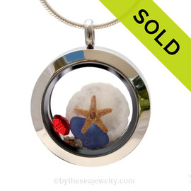 Pieces of genuine sea glass in blue a real mini starfish, sandollar and a vivid ruby red gem completes this mini sea glass locket necklace. Sorry this Sea Glass Jewelry selection has been sold!