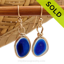 An ultra rare match of mixed flashed blue English sea glass pieces from Seaham England in our Original Gold Wire Bezel© sea glass earring setting. Sorry these Ultra Rare Sea Glass Earrings h ave been SOLD!