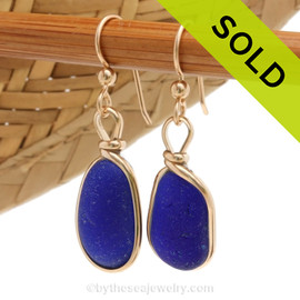 Vivid petite cobalt blue sea glass pieces set in our Original Wire Bezel© setting. SOLD - Sorry these Sea Glass Earrings are NO LONGER AVAILABLE.