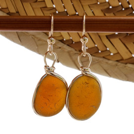 Beautiful vivid amber brown sea glass pieces left just the way they were found on the beach in Puerto Rico are set in our Original Wire Bezel© setting in 14K Rolled Gold