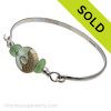 Two pieces of beach found sea glass in vivid yellowy seafoam green on this solid sterling silver half round sea glass bangle bracelet.  Sorry this Sea Glass Bracelet has been SOLD!