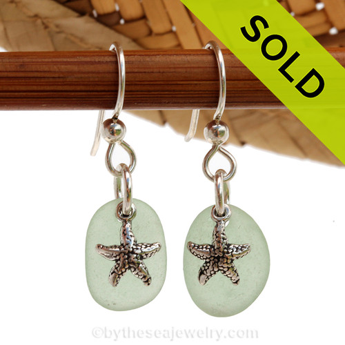 A perfect matched pair of beautiful seafoam green Sea Glass Earrings combined with solid sterling starfish charms and a setting that leaves much of the beauty of these sea glass pieces shine. SOLD - sorry this Sea Glass Jewelry selection is no longer available.