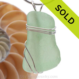 A large piece of  yellowy seafoam green sea glass set in a secure triple sterling silver setting. Sorry this Sea Glass Pendant has been SOLD!