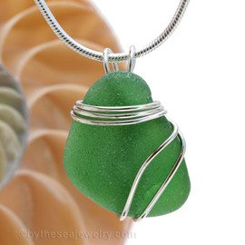 A large piece of  vivid green sea glass set in a secure triple sterling silver setting.