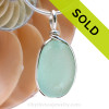 A lovely piece of beach found glass from Seaham England in a stunning aqua green is set in our Original Wire Bezel© pendant setting. Sorry this piece of sea glass jewelry has been sold!