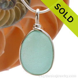 A lovely piece of beach found glass from Seaham England in a stunning aqua blue is set in our Original Wire Bezel© pendant setting. Sorry, this Sea Glass Jewelry piece is no longer available.!