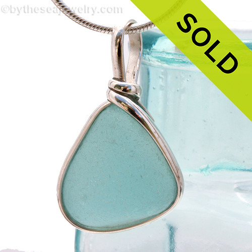 A lovely piece of beach found glass from Seaham England in a stunning aqua blue is set in our Original Wire Bezel© pendant setting. SOLD - Sorry This Sea Glass Jewelry Selection Is NO LONGER AVAILABLE!
