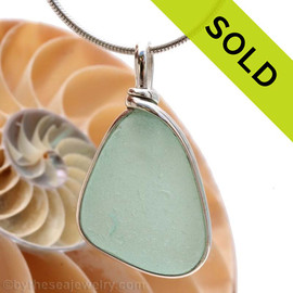 A lovely piece of beach found glass from Seaham England in a aqua green is set in our Original Wire Bezel© pendant setting. Sorry this Sea Glass Jewelry selection has been SOLD!