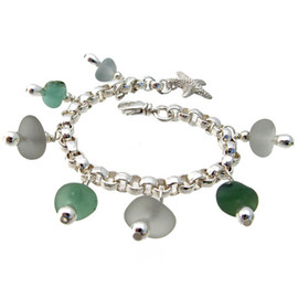 A stunning sea glass bracelet made entirely of genuine beach found glass. This is on a heavy fully soldered chain, guaranteed for a lifetime of enjoyment!