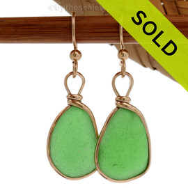 Genuine beach found vivid green sea glass earrings in a 14K Rolled Gold Original Wire Bezel setting. Very unusual Chartreuse or Lime green perfectly matched sea glass pieces. REMEMBER- We do no alter or shape our sea glass in any way.