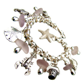 Lavender Sea Glass Bracelet. Amazing deep purple real sea glass pieces are combined with solid sterling charms on a fully soldered bracelet. Charms include lobster, jellyfish, sandollar, seahorse, shells and more!