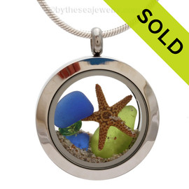 Genuine lime green and cobalt blue sea glass piece combined with a real starfish and a real beach sand in this stainless steel locket. Sorry this sea glass jewelry piece has been sold!