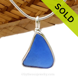 A simple lieghtweight piece of Cobalt Blue Genuine Sea Glass with in our signature Original Wire Bezel© pendant setting. Sorry this piece of sea glass jewelry has been sold!