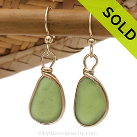 Genuine beach found vivid citron green sea glass earrings in a 14K Rolled Gold Original Wire Bezel setting. Sorry this Sea Glass Jewelry selection is NO LONGER AVAILABLE!