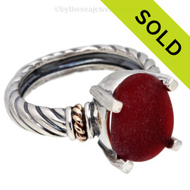 A very rare piece of Bright Red Genuine Sea Glass in a Sterling ring setting highlighted with 14k gold accents. Sorry , this one of a kind Sea Glass Ring has been SOLD!