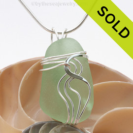 A nice TOP QUALITY piece of Yellowy Seafoam Green Genuine Sea Glass Pendant set in our Signature Waves© setting in Sterling Silver. Sorry this piece of sea glass jewelry has been sold!