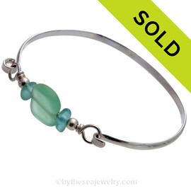 Two pieces of beach found sea glass in a blue on this solid sterling silver half round sea glass bangle bracelet.  Sorry this Sea Glass Jewelry piece has been SOLD!