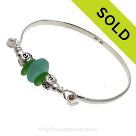 Two pieces of beach found sea glass in a vivid green with a handmade aqua center  bead  on this solid sterling silver half round sea glass bangle bracelet.  SOLD - Sorry This Sea Glass Bracelet Is NO LONGER AVAILABLE!