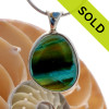AN ULTRA RARE Mixed Olive Green & Electric Vivid Aqua Genuine Rare English Sea Glass piece set in our Deluxe Wire Bezel© necklace pendant setting. SOLD - Sorry This ULTRA RARE Sea Glass Necklace Pendant Is NO LONGER AVAILABLE!