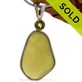 This beautiful Bright Peridot Green sea glass piece is set in our Deluxe Wire Bezel© pendant setting with a genuine Peridot brilliant cut gem. SOLD - Sorry this Rare Sea Glass Pendant is NO LONGER AVAILABLE!
