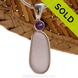 This beautiful Bright Perfect Purple sea glass piece is set in our Deluxe Wire Bezel© pendant setting with a genuine Amethyst brilliant cut gem. Sorry this Sea Glass Jewelry selection has been SOLD!