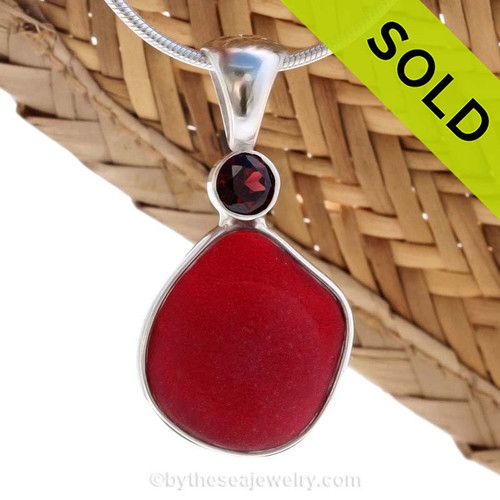 This beautiful ULTRA RARE Ruby Red sea glass piece is set in our Deluxe Wire Bezel© pendant setting with a genuine Garnet Brilliant Cut gem. Sorry this Sea Glass Jewelry selection has been SOLD!