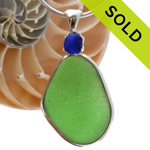 This beautiful Vivid Green glass piece is set in our Deluxe Wire Bezel© pendant setting with a small cobalt blue prong set sea glass focal point. Sorry this Sea Glass Pendant is no longer available.