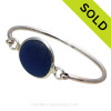 Genuine Deep Blue Sea Glass Bangle Bracelet set in our Deluxe Wire Bezel© sterling silver setting. Sorry this sea glass jewelry selection has been sold!
