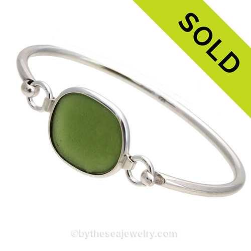 Genuine Sea Glass Bangle Bracelet in a vivid Olive Green set in our Deluxe Wire Bezel© sterling silver setting. Sorry this Sea Glass jewelry piece has been SOLD!