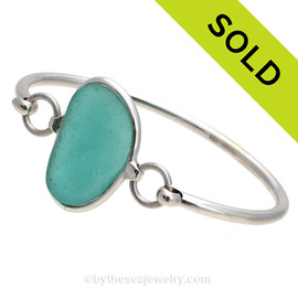 Genuine Vivid Aqua Sea Glass Bangle Bracelet set in our Deluxe Wire Bezel© sterling silver setting.