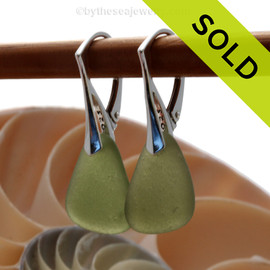 Simple beach found jungle green sea glass pieces on solid sterling silver deco hooks. Sorry this Sea Glass Jewelry selection has been SOLD!