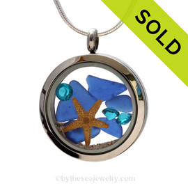 Beautiful pieces of natural Cobalt Blue sea glass combined in a stainless steel locket necklace with a real starfish & Zircon crystal Gems. Sorry this Sea Glass Locket Necklace has been SOLD!
