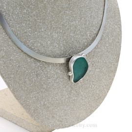 A stunning large aqua sea glass set in fine silver and sterling silver necklace slide. This piece comes on a solid sterling satin finished oval collar.