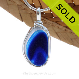An rich vivid mixed Blue English Multi sea glass set for a necklace in our Original Sea Glass Bezel© in solid sterling silver setting. Sorry this one of a kind piece of Sea Glass Jewelry has been SOLD!