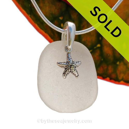 A perfect piece of natural beach found white sea glass is combined with a solid starfish charm and presented on an 18 Inch solid sterling snake chain.  Sorry this Sea Glass Necklace has been sold!