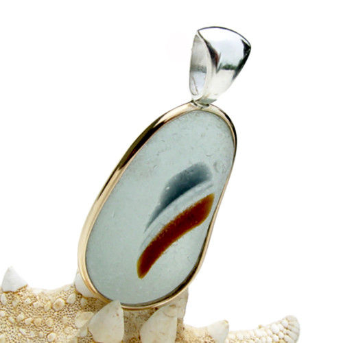This amazing multi color sea glass piece is versatile in a mixed metal Deluxe Wire Bezel© pendant setting.