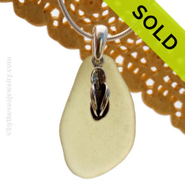 A perfect piece of natural beach found pale citron green sea glass is combined with a solid flip flop charm and presented on an 18 Inch solid sterling snake chain. Sorry this Sea Glass Necklace has been SOLD!