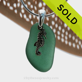 A perfect piece of deep aqua green sea glass is combined with a solid sterling sea horse and presented on an 18 Inch solid sterling snake necklace chain. Sorry this Sea Glass Necklace has been SOLD!