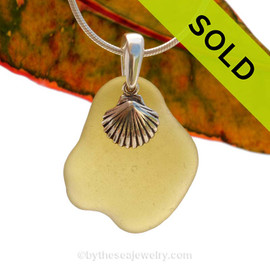 A perfect piece of natural beach found vivid citron green sea glass is combined with a solid flip flop charm and presented on an 18 Inch solid sterling snake chain. Sorry this Sea Glass Jewelry selection is NO LONGER AVAILABLE!