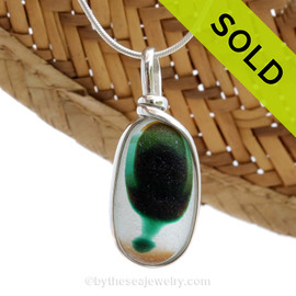 A beautiful piece of tricolor multi  teal green with amber mixed multi sea glass set for a necklace in our Original Sea Glass Bezel© in solid sterling silver setting. SOLD - Sorry This Sea Glass Jewerly Selection Is NO LONGER AVAILABLE!