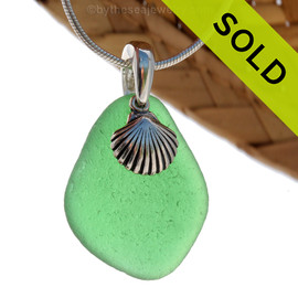 Larger Green sea glass set on a solid sterling cast bail with a sterling silver shell charm. Sorry this Sea Glass Necklace has been SOLD!