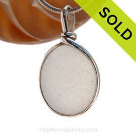 A larger piece of pure white sea glass in a naturally shape. This piece is set in our Original Wire Bezel© in sterling silver. Sorry this piece of Sea Glass Jewelry has been SOLD!
